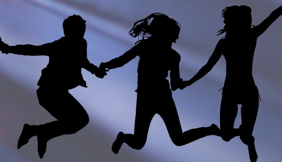 Blije mensen springen en dansen